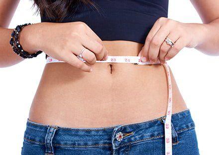 benefios-da-dieta-detox-mulher-vencedora-perder-peso